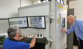 Newbury Electronics' managing director, Philip King (right) and Dave Roe, Senior Production Technician, with the XT V 160.