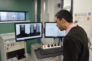Parmesh observes the results of the mechanism which shakes the beads at intervals between CT scans.