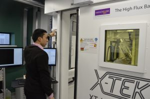 Parmesh Gajjar, Reasearch Associate at the Henry Moseley X-ray Imaging Facility closes the door on the XT H 225 WIR (walk-in room).