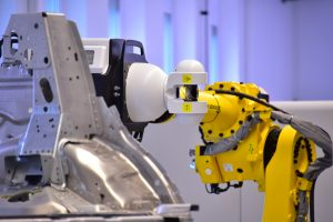 A Laser Radar mounted on a robot measures studs on a car body component in absolute coordinates.